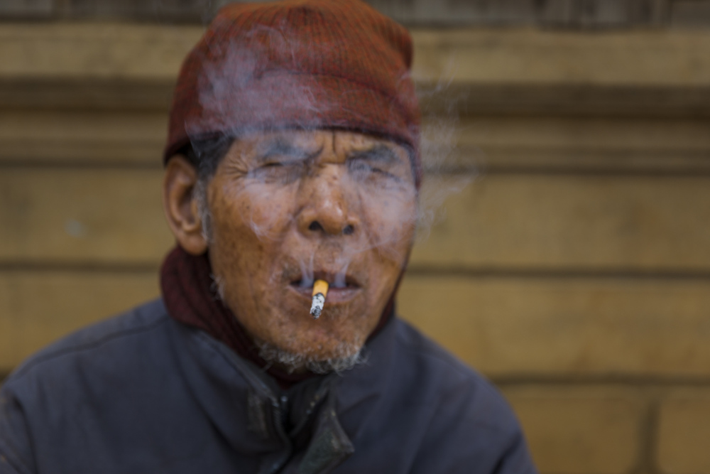 "An 80 year old Koho man ""enjoys"" a smoke."