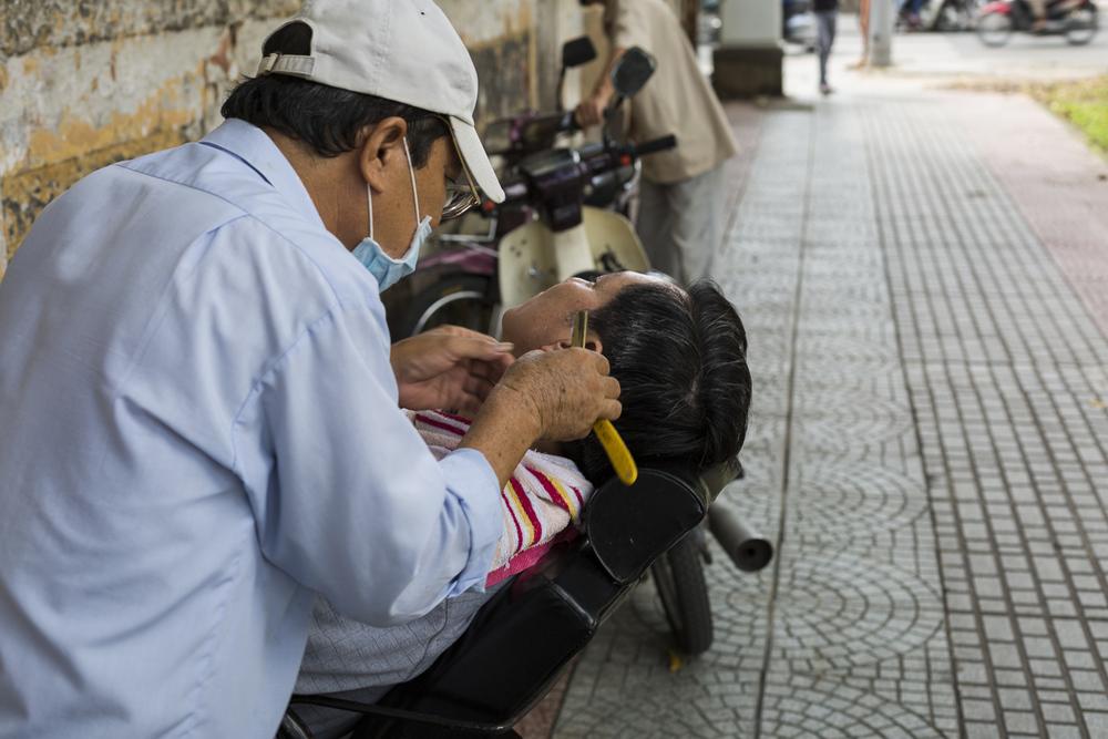 Street barber. 23 years.