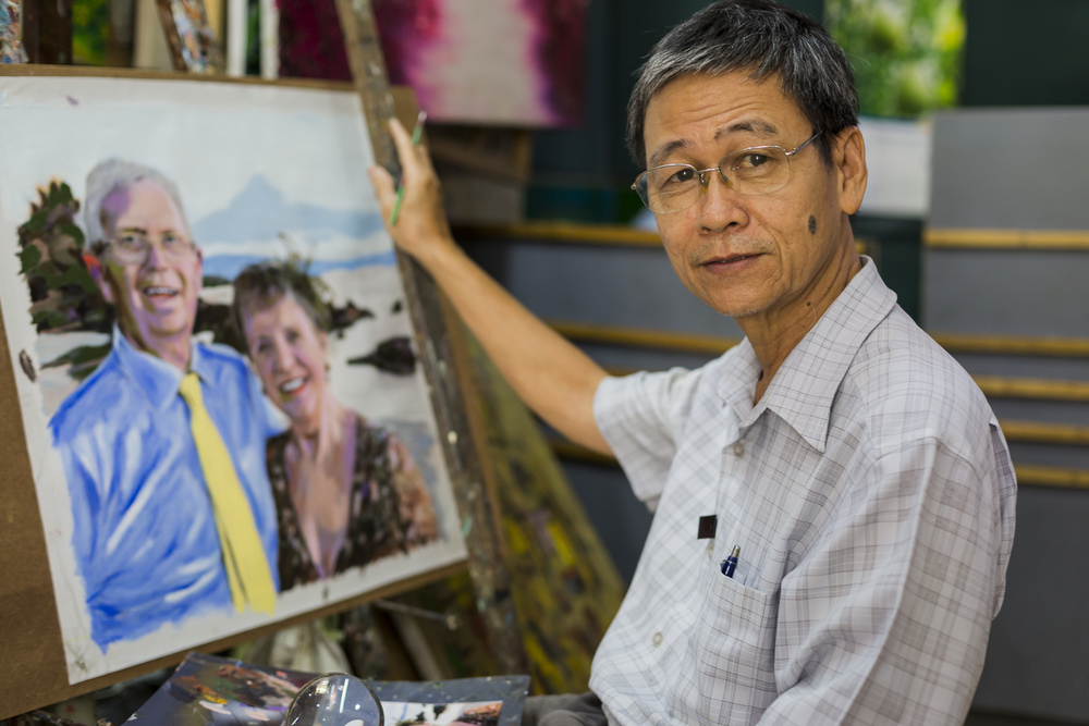 Artist. Mr Cuong. Painting for 40 years, mostly from the same arcade in District 1.