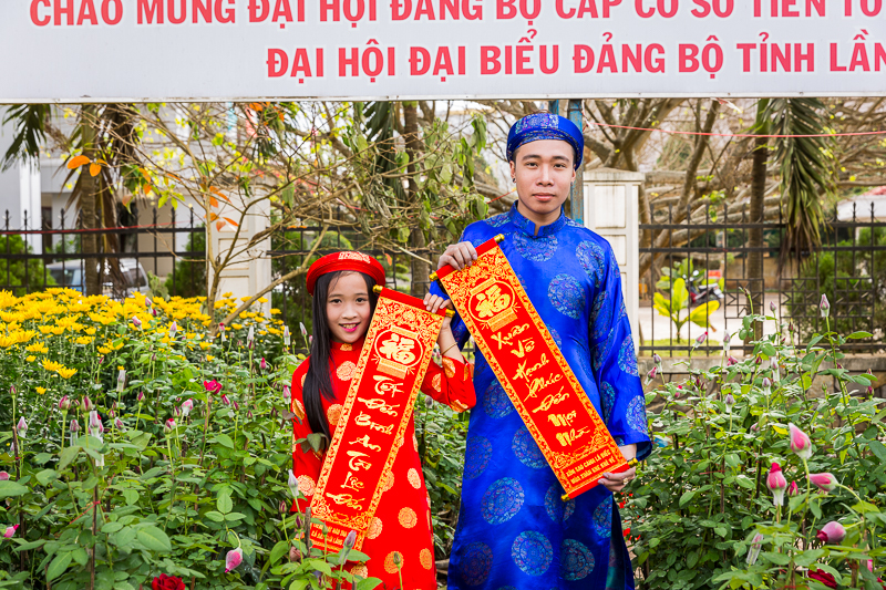 Brother and sister in traditional dress out for a new year photoshoot.