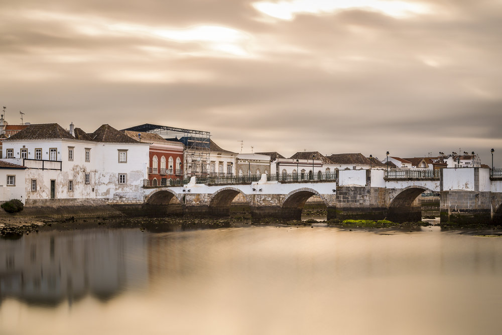 The Gilao River and Roman Bridge at sunset. Tavira, Portugal.
