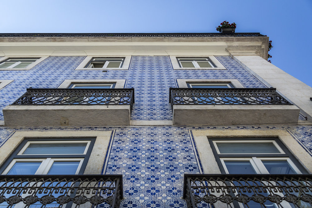 Typical Lisbon architecture. The outside of a building covered in azulejos tiles