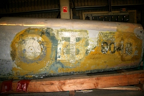 Wartime serial number appears under later paint layers