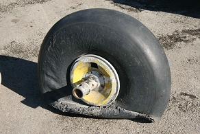 Original main wheel and its disintegrating tyre