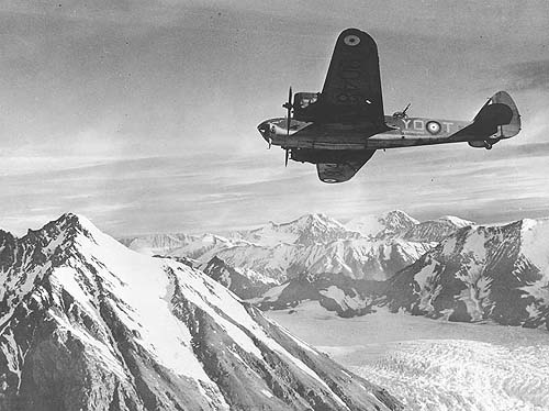 Stunning photo of Bolingbroke 9048 over Alaskan mountains some time in 1942, taken by photographer Nick Moran