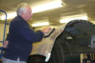 Volunteer repairing the rear fuselage