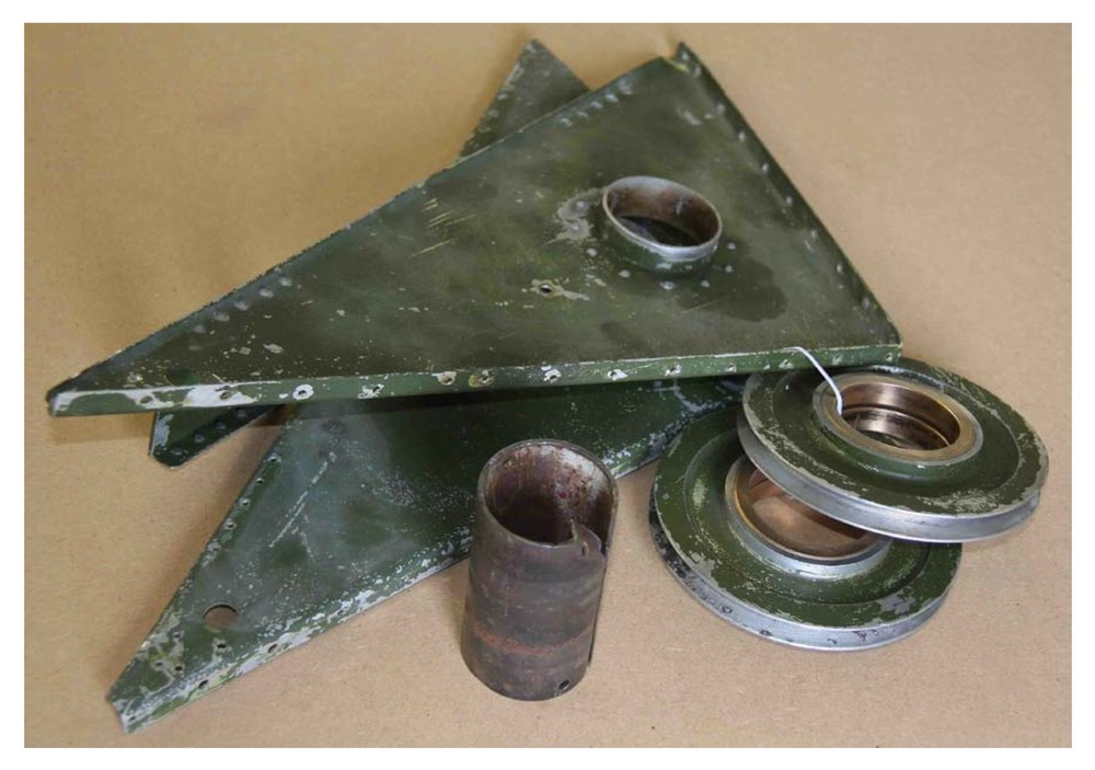 One of the dismantled flap pulley units showing the corroded tubular bearing after extraction