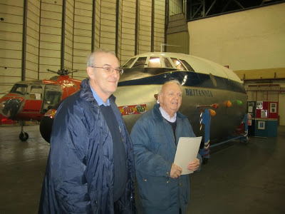 Roger Hargreaves of the Britannia Aircraft Preservation Trust (left) and Oliver Dearden of the Bristol Aero Collection Trust (right) during the hand-over at Filton, with Britannia 'RX behind.