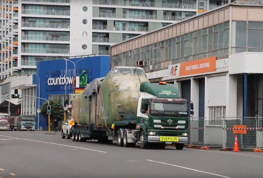 On the road - The Freighter is transported by road to the Port of Auckland