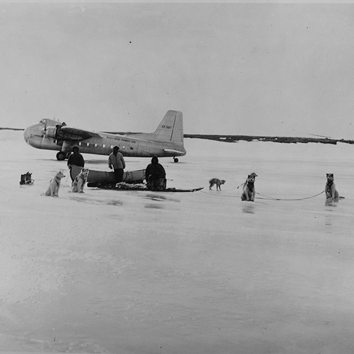 Inuit crossing Annadin, Lake, Canada, Type 170 in background, 17 Jun 1952