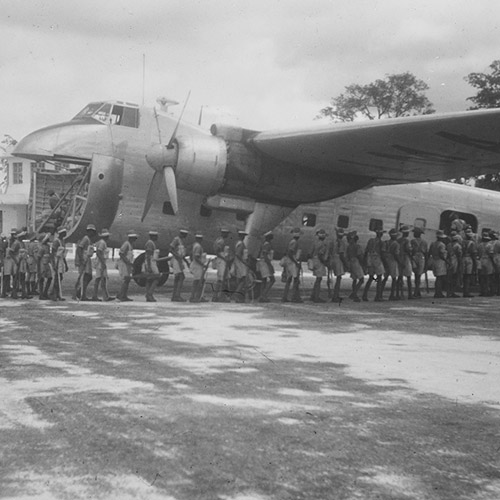 In Africa loading local troops, Jul 1949