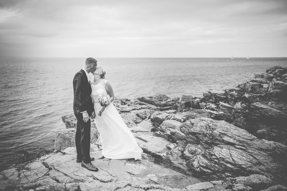 Berry Head wedding portrait photograph of bride and groom kissing.