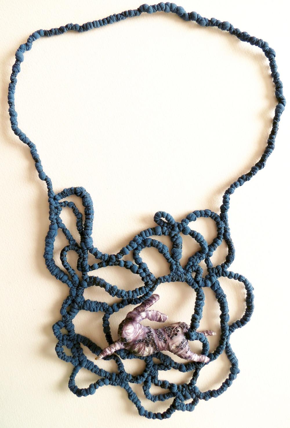 Down the Rabbit Hole - Francesca Cecchini (2013), necklace // Materials: repurposed nylon stockings, kitchen foil, copper wire, glass beads, translucent polymer clay, silk thread.