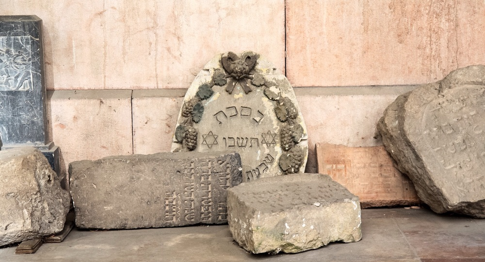 Jewish gravestones being restored at a synagogue