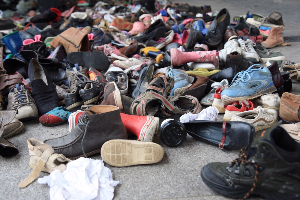 Old shoe pile from children who were travelling here by foot