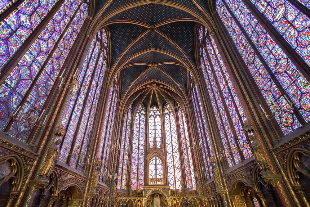 Stained glass windows depict the entire story of the bible, covering all the walls.