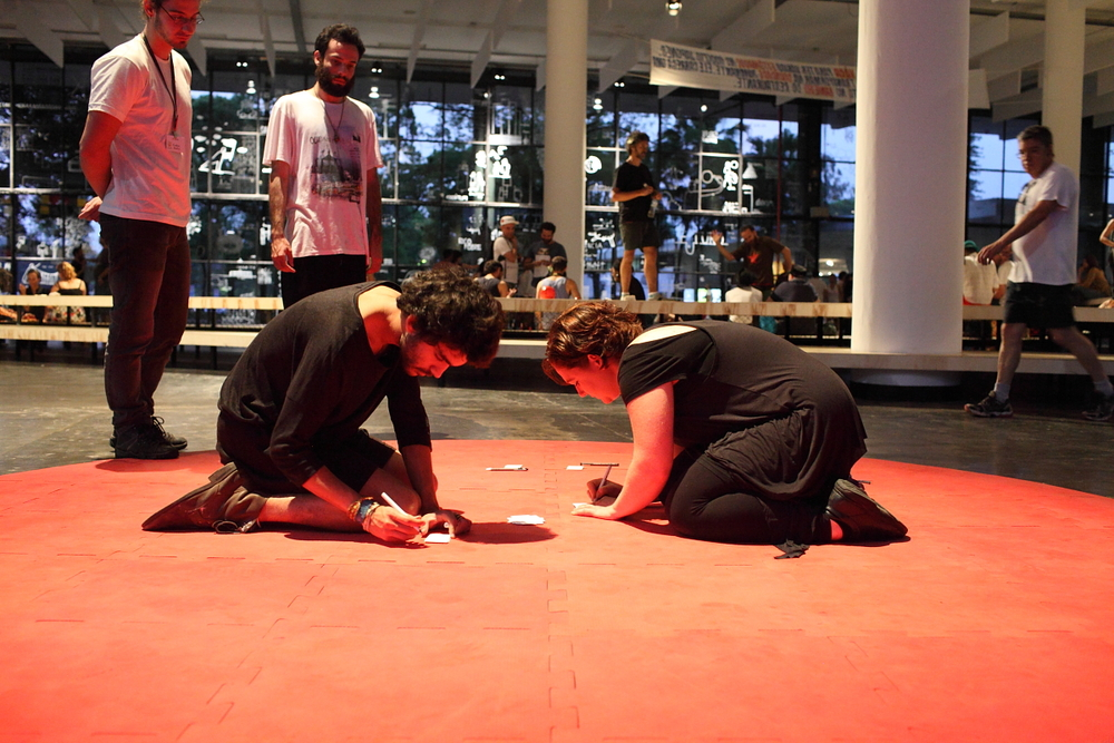 Notes on Not-Knowing is a two person telepathic engagement that Honi and I developed in early August 2014 in Berlin. And now we brought it with us to the Sao Paulo Bienale for the Perpendicular Bienale Intervention. The text based work demands silence, and focus on the connection between two people. The nature of this work is the kind that doesn't cease to surprise amuse and humilify its participants. For the first time, we opened the piece to the passer by-  and let people try their telepathic abilities (paired perhaps with chance and coincidence). What emerges is something between a poetic and fragmented text with moments of harmony - a series of moments shared as a connection, embodied in a text. (click the image for documentation) and  here  for a link to Honi's blog; documentation of the first time we did 'Notes' in Berlin.