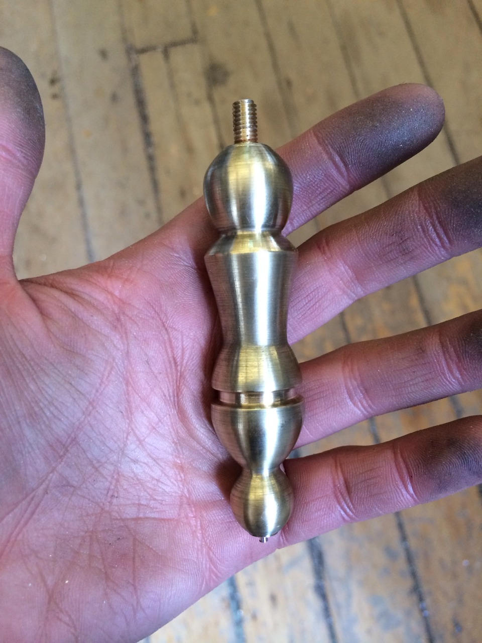Second polished brass piece