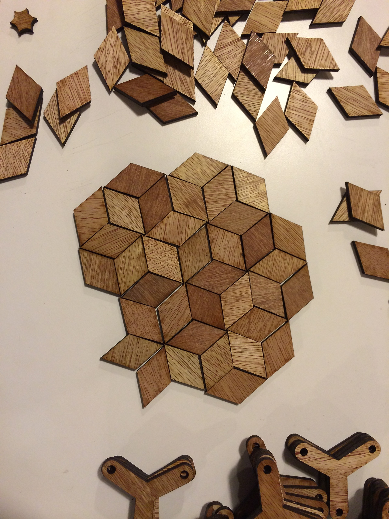 The negative spaces from the Honeycomb Triangle pieces!  I was thrilled to discover that the triangle units left behind by the laser cutter were the same as the Penrose Fat Rhomb.