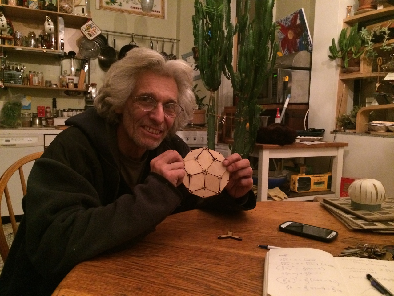Gary Faro, mathematician and artist.  Introduced to me by an incoming student at the ITP welcome party, I paid him a visit at his Brooklyn home.  Gary generously sat with me for hours and explained his own math formulas and shared his insights into geometry and art.  Here he is holding one of my Penrose decagons!