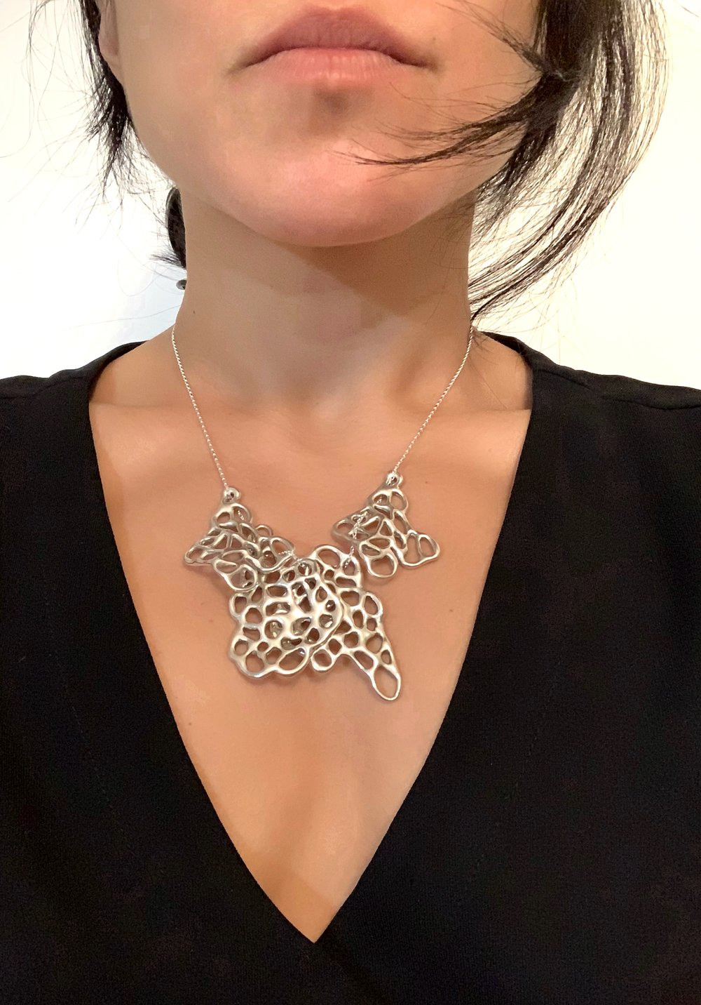 Wyna Cell Leaf Necklace Worn.jpg