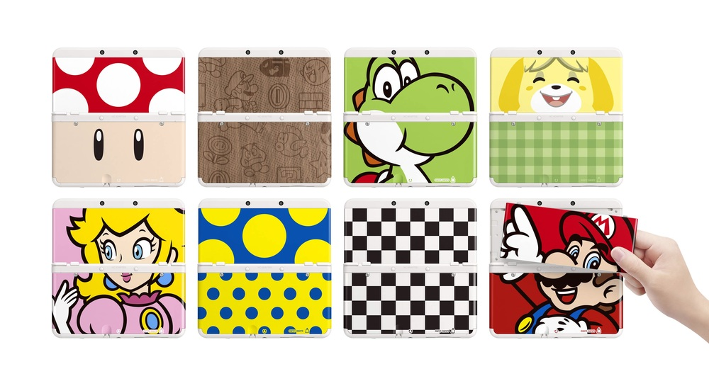 The smaller New 3DS with different faceplates