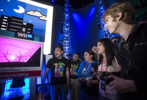 """In this photo provided by Nintendo of America, attendees compete in a wild nine-player multiplayer race in Runbow by 13AM Games at Nindies@Night, a special event celebrating recently released and upcoming independent games at EMP Museum in Seattle on Aug. 27, 2015. The free event featured a presentation from """"Nindie"""" developers, many different playable games, multiplayer competitions and giveaways."""