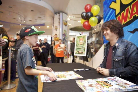 For Photo #5In this photo provided by Nintendo of America, Founder, President/CEO of LEVEL-5 Inc. Akihiro Hino signs autographs and poses for pictures with fans at the launch of the YO-KAI WATCH video game for the Nintendo 3DS family of systems at Nintendo World in New York on Nov. 7, 2015.