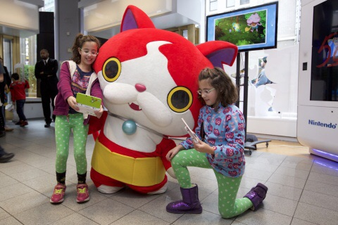 For Photo #4  In this photo provided by Nintendo of America, fans meet and interact with YO-KAI WATCH character Jibanyan at Nintendo World in New York on Nov. 7, 2015, as part of the YO-KAI WATCH launch event. YO-KAI WATCH launched on Nov. 6, 2015 and is available exclusively for the Nintendo 3DS family of systems.