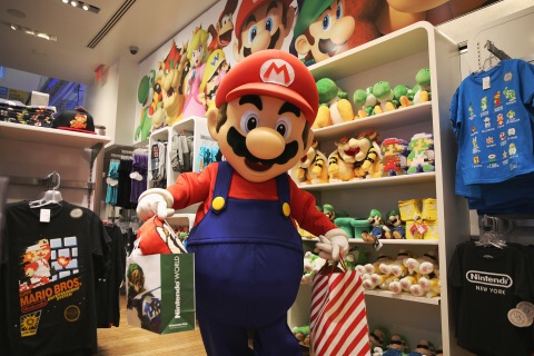 Mario loads up with Nintendo goodies for the holidays at the Nintendo World store in New York on Nov. 11, 2015. Retailers nationwide are offering Black Friday deals on Nintendo games, and Wii U and Nintendo 3DS systems. (Photo: Business Wire)