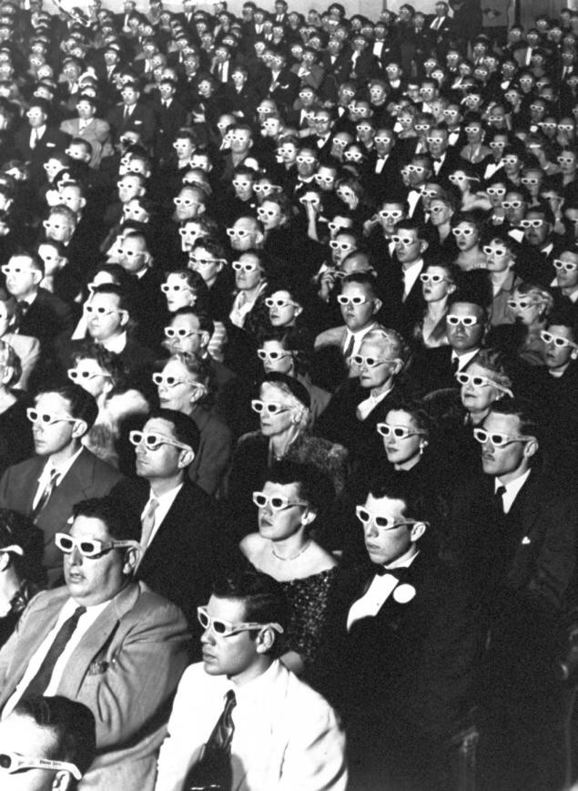 Formally-attired audience sporting 3-D glasses during opening night screening of movie Bwana Devil.