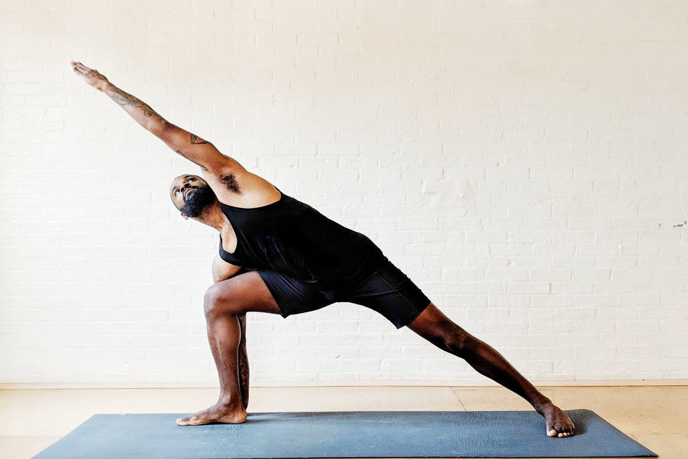 Justin Timothy Temple in triangle pose