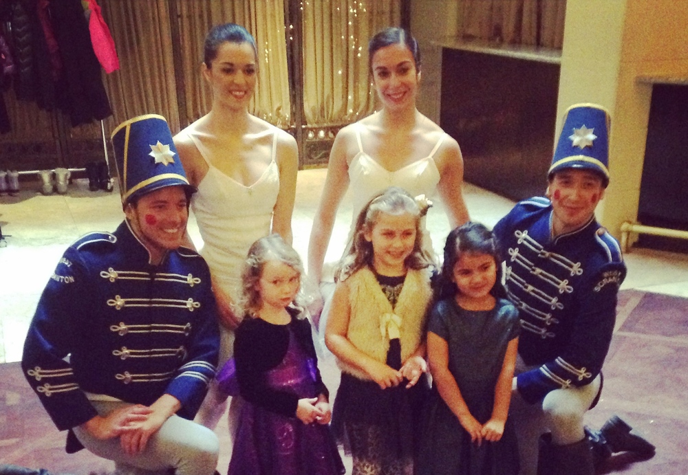 Toy Soldiers and Ballerina Hosts posing with their biggest fans