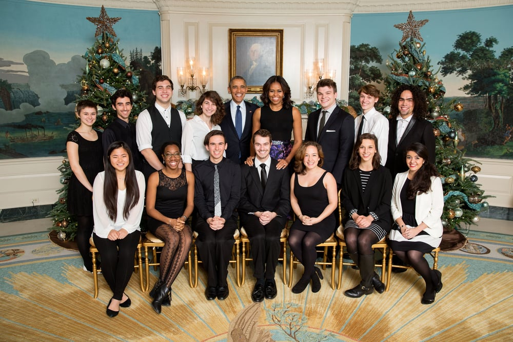President Barack Obama and First Lady Michelle Obama join the Vassar Devils for a group photo and listen to them perform in the Diplomatic Reception Room prior to Christmas holiday EOP Reception #1 at the White House, Dec. 11, 2015. (Official White House Photo by Lawrence Jackson)