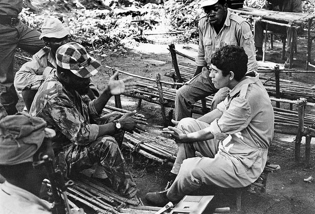 A Portuguese prisoner-of-war talking to his captors in Mozambique. Image Source: Flickr/un_photo