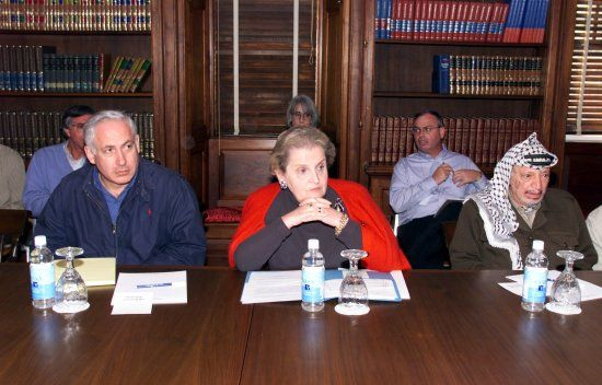 Madeleine Albright (C), Benjamin Netanyahu (L) and  Yasser Arafat Image Source: Wikimedia Commons