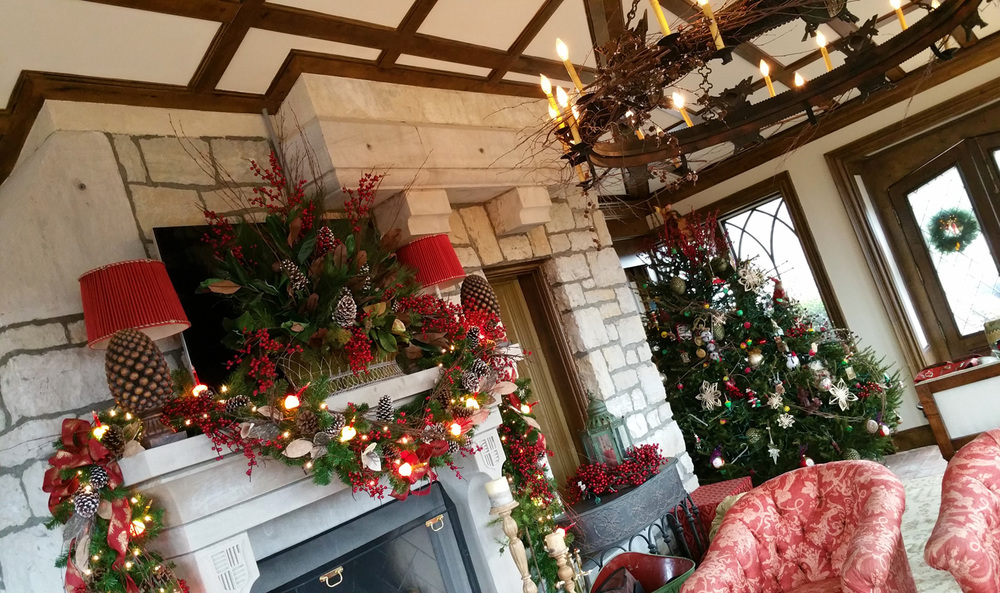 Accompanying the shabby chic tree in this large conservatory room, we also adorned the mantel and the stoic chandelier with crystallized branches, pine cones, bubble lights and berries.