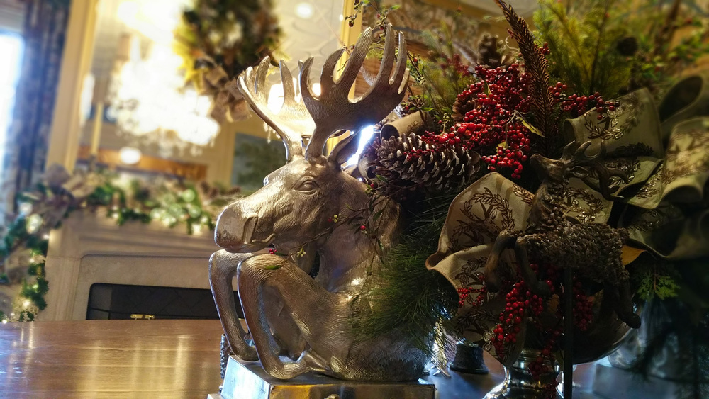 Last, but certainly NOT LEAST, the dining room table and mantel were amply lavished in the lodge theme with stunning platinum moose bust plaques, mirroring each side of the centerpiece.