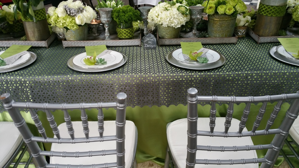 Silver Chiavari Chairs compliments of Fifty Chairs complimented the silver chargers and charcoal cut-out topper.