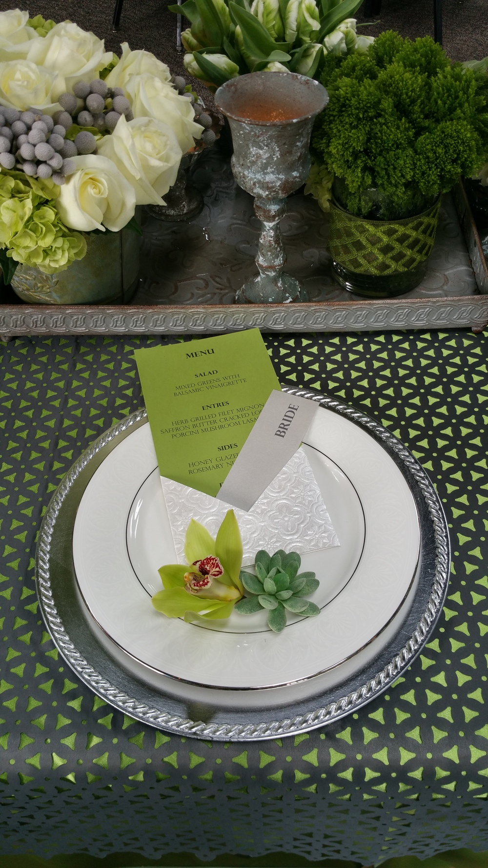 Individual menus were added as a detail at each setting. Each with a unique ornamental paper pocket also holding the place cards.