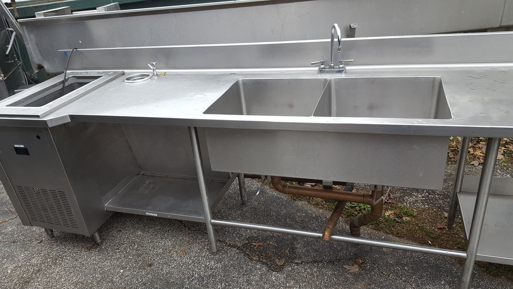 This sink/counter is just one piece of the equipment bought at auction