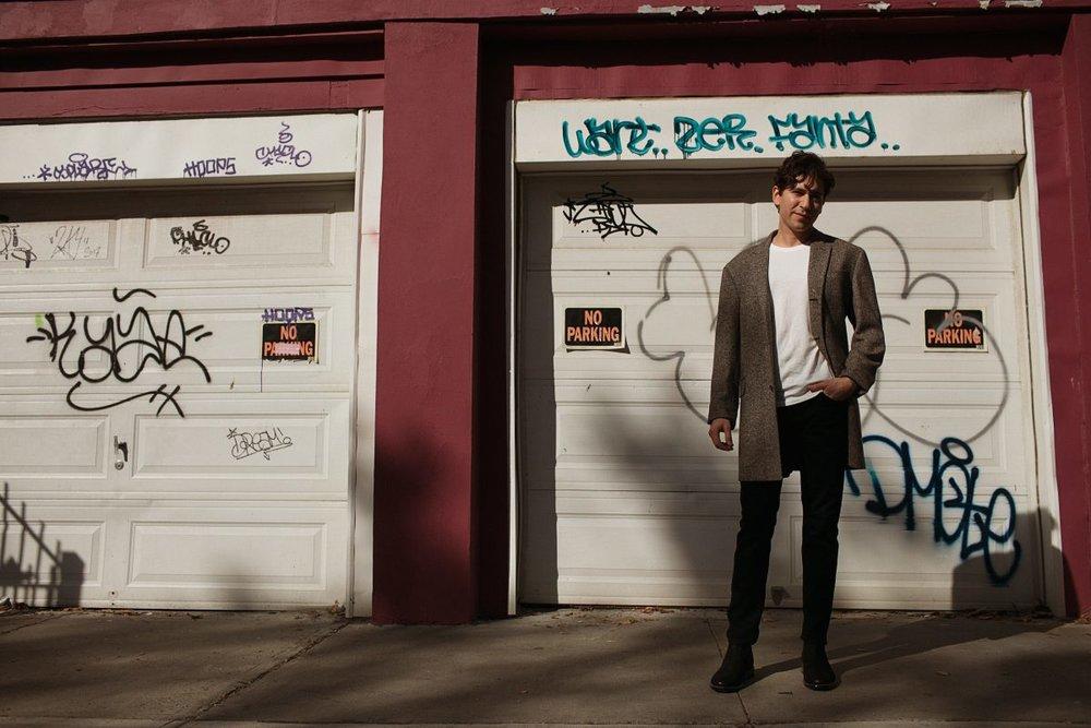 Coat by Deveaux New York, Pants by Levi's, Shoes by Vagabond.