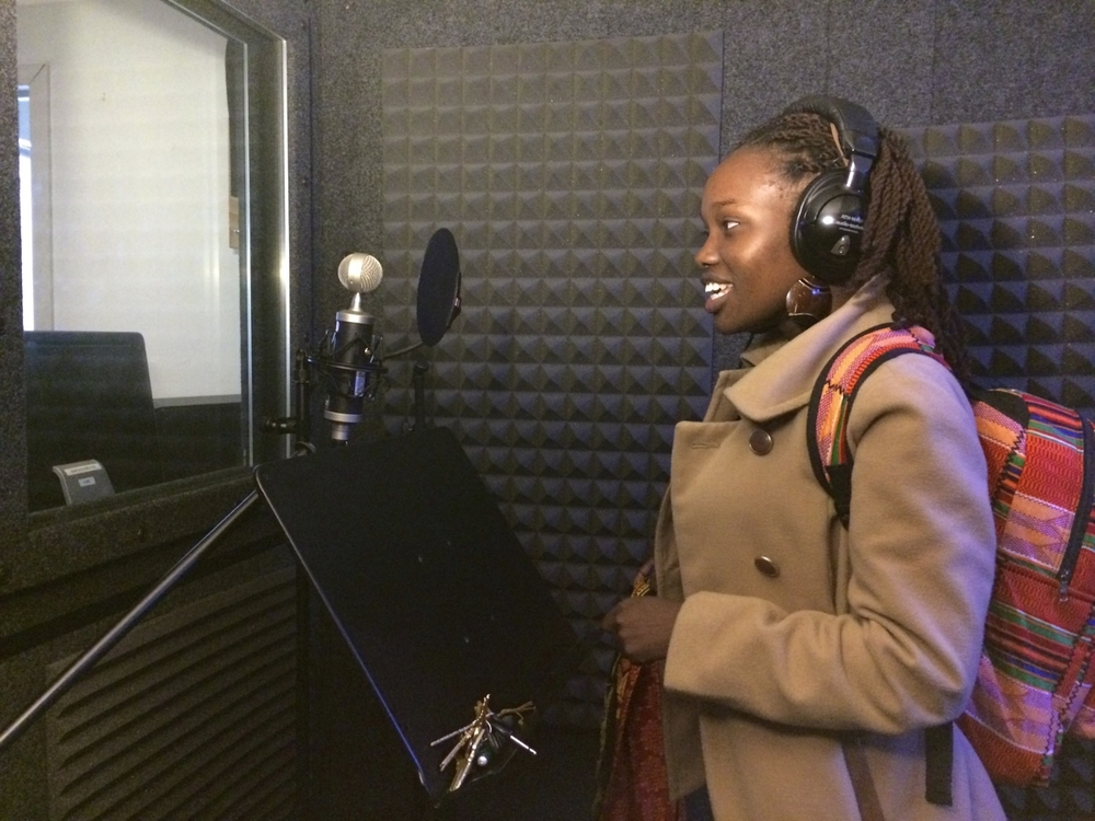 Alumna, Faith, tests out the recording studio at Bay Area Video Coalition