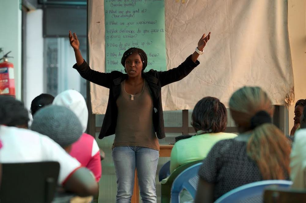 Michelle facilitating a mentoring session with girls in Kibera. Photo credits - Koen Suidgeest.