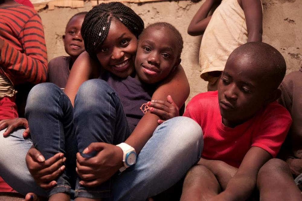 Michelle with kids in Kibera. Photo credits - Koen Suidgeest