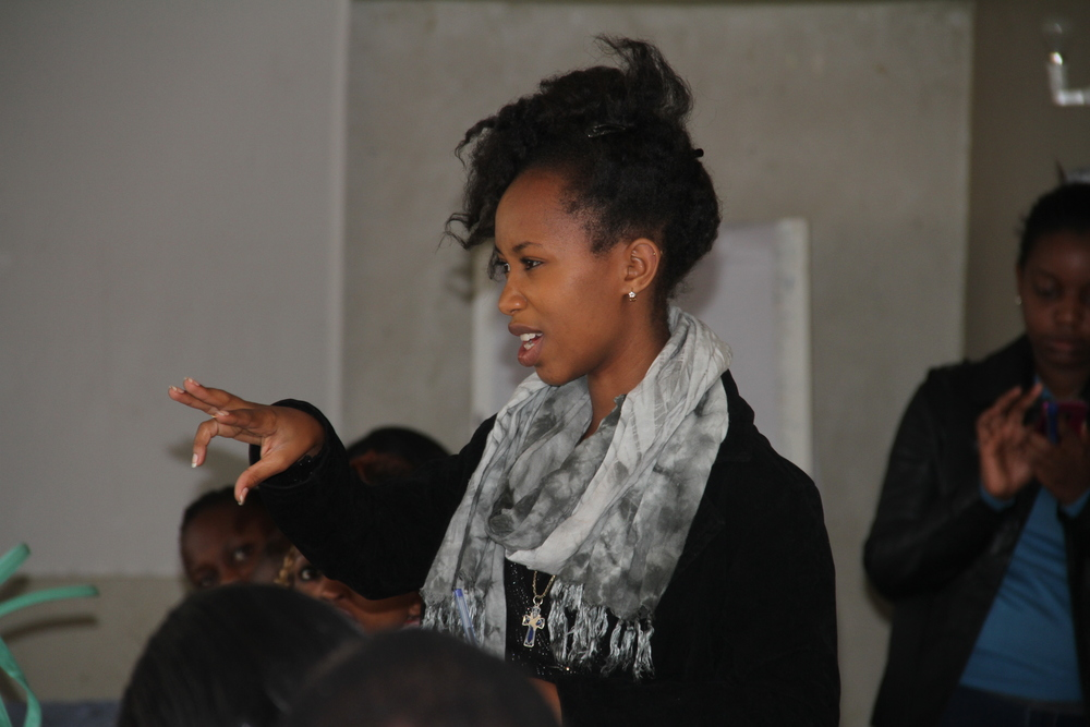 Akili Dada Alumna Sharon sharing her thoughts at the Dialogues session in Bomet.