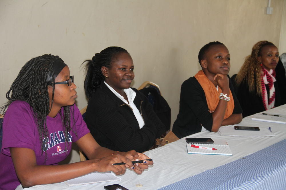 Akili Dada alumnae and mentors sitting for the Bomet Dada Dialogues session.