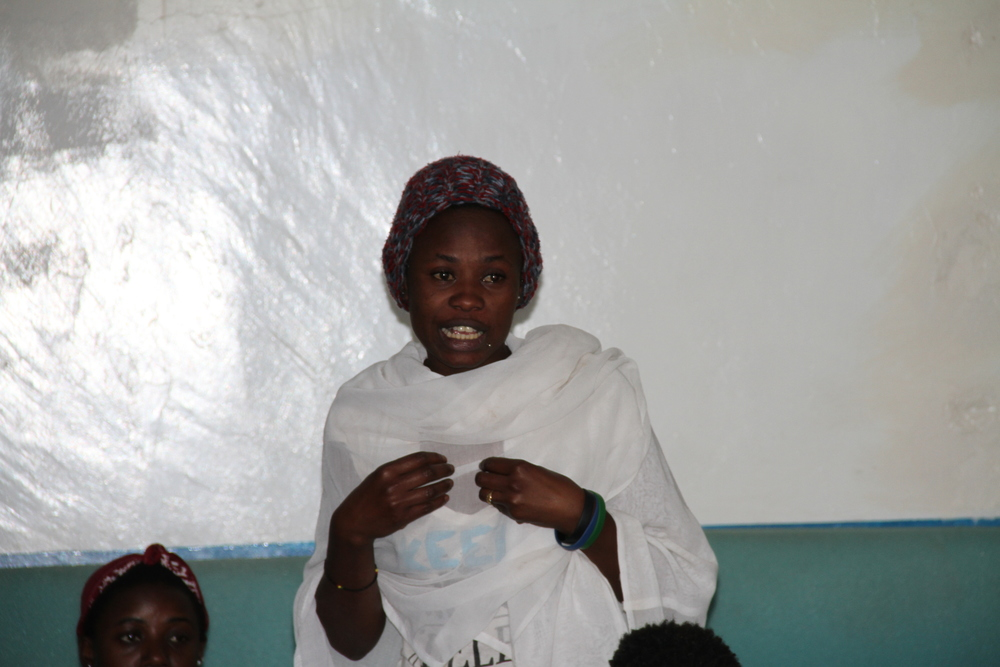 Young woman giving her views at the dialogue.
