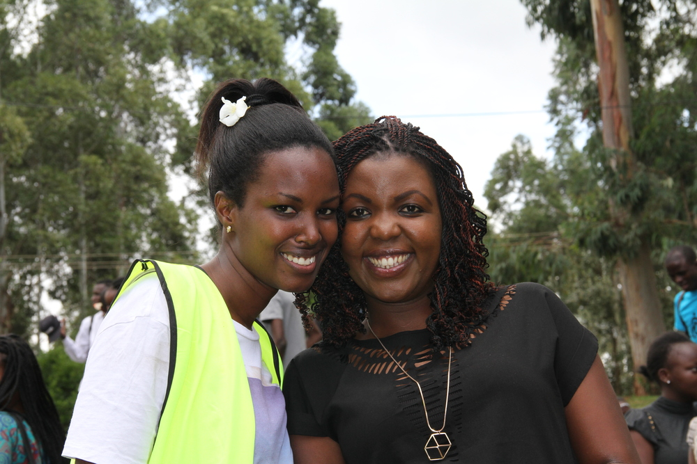 Purity Wanjohi with one of the volunteers for the clean up.