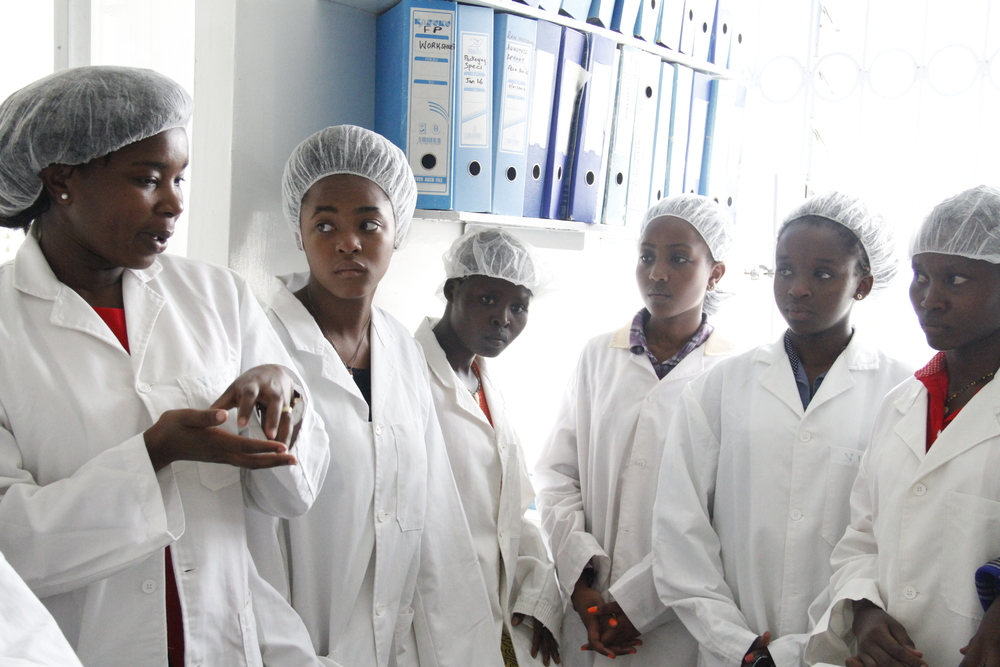 Students from the Girls Leadership Academy at a site visit in Osschemi, a pharmaceutical manufacturing company in Nairobi. On the left is the Quality Control Manager - Maryanne Aketch.